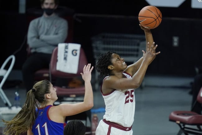 Oklahoma guard Madi Williams (25) shoots in front of Kansas forward Ioanna Chatzileonti (11) in the second half of the Sooners' 84-81 win on Jan. 27 in Norman. [AP Photo/Sue Ogrocki]