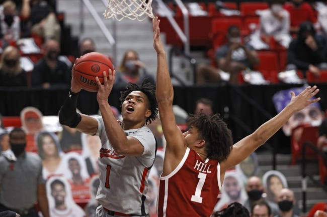 Texas Tech's Terrence Shannon Jr., left, lays up the ball around Oklahoma's Jalen Hill, right, during the second half of a 57-52 win Monday night in Lubbock, Texas. [AP Photo/Brad Tollefson]
