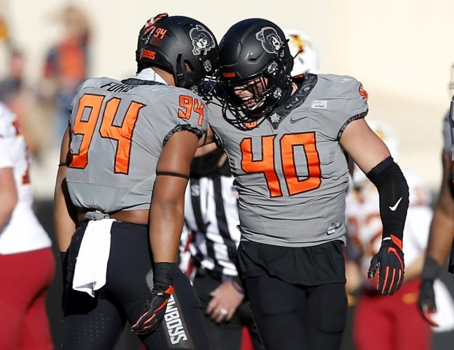 Oklahoma State's Trace Ford (94) celebrates his sack with Brock Martin (40) during the college football game against Iowa State at Boone Pickens Stadium in Stillwater. [SARAH PHIPPS/THE OKLAHOMAN]