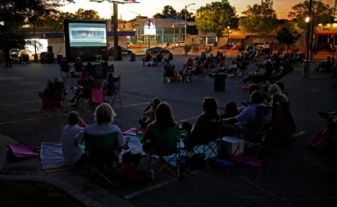 A crowd watches an outdoor screening during the 2020 deadCenter Film Festival in the parking lot of the Tower Theater Friday, June 12, 2020. [Doug Hoke/The Oklahoman Archives]