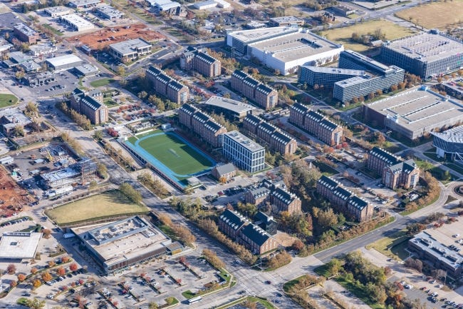 The Chesapeake Energy campus represents the vision of the late Aubrey McClendon, who lead the company until 2013. The headquarters consists of Georgian collegiate style buildings (center of photo) and contemporary buildings on the east half of the campus. Commercial development to the south of west of the campus, also originally conceived by McClendon, includes the Whole Foods, lower left, and the Ellison Hotel, being built across from the company's athletic field. [PROVIDED BY CHESAPEAKE ENERGY]