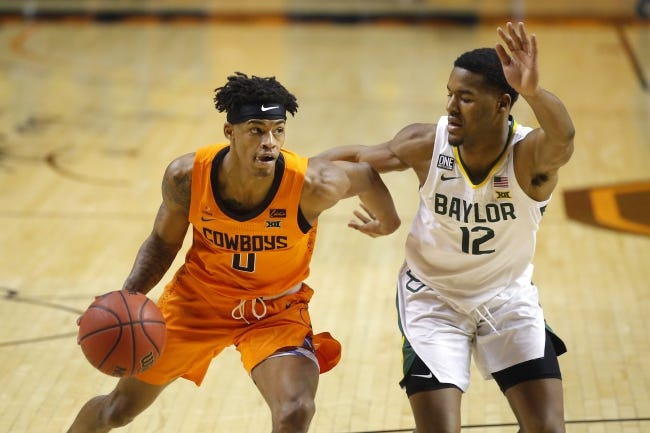 Oklahoma State's Avery Anderson III, left, goes past Baylor's Jared Butler earlier this season. [Bryan Terry/The Oklahoman]