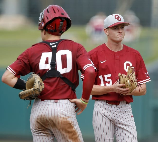 Oklahoma's Wyatt Olds (15) stands next to Brady Lindsly (40) during a Big 12 tournament game against TCU at Chickasaw Bricktown Ballpark on May 23, 2019. [Bryan Terry/The Oklahoman]