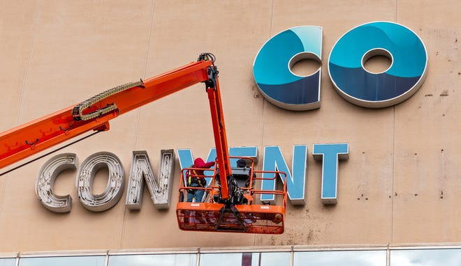 Crews work to remove the Cox Convention Center name from the Prairie Surf Studios. The convention center has been converted to sound stages and production offices. [CHRIS LANDSBERGER/THE OKLAHOMAN]
