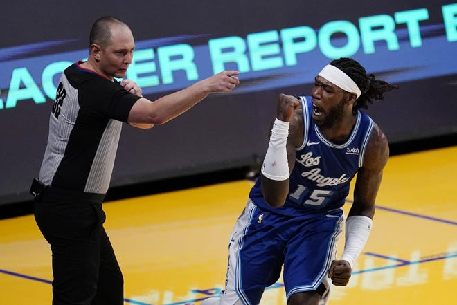 Lakers center Montrezl Harrell, right, reacts after a call in the team's favor during the second half against the Nuggets on Thursday. [AP Photo/Marcio Jose Sanchez]