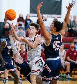 Oklahoma Christian Academy's Karson Fellers goes between Southwest Covenant's Bryson Ford, left, and Anthony Cox during a high school basketball game between Oklahoma Christian Academy and Southwest Covenant in Edmond, Okla., Friday, Feb. 5, 2021. [Bryan Terry/The Oklahoman]