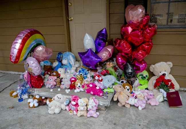 Stuffed animals and candles have been placed as a memorial in Muskogee, Okla. on Thursday, Feb. 4, 2021, at the home of a mass homicide where five children and a man were fatally shot on Tuesday. [Chris Landsberger/The Oklahoman]