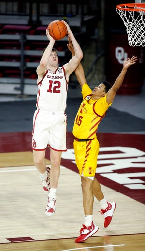 Oklahoma's Austin Reaves shoots as Iowa State's Rasir Bolton defends during Saturday's game at the Lloyd Noble Center. [Photo by Sarah Phipps, The Oklahoman]