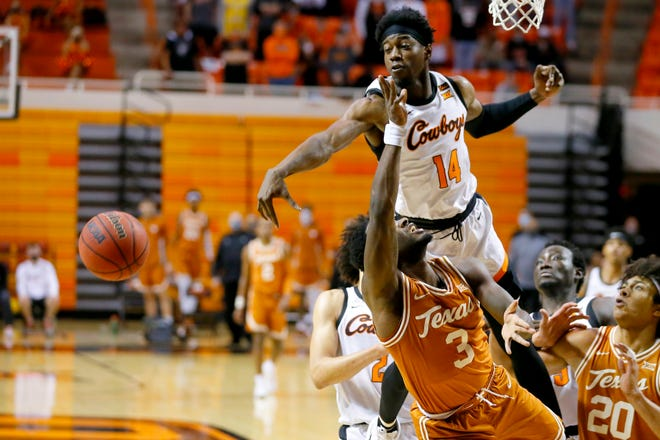 Oklahoma State's Bryce Williams (14) is called for a foul as he defends Texas' Courtney Ramey (3) during an NCAA basketball game between the Oklahoma State Cowboys (OSU) and the Texas Longhorns at Gallagher-Iba Arena in Stillwater, Okla., Saturday, Feb. 6, 2021. [Bryan Terry/The Oklahoman]