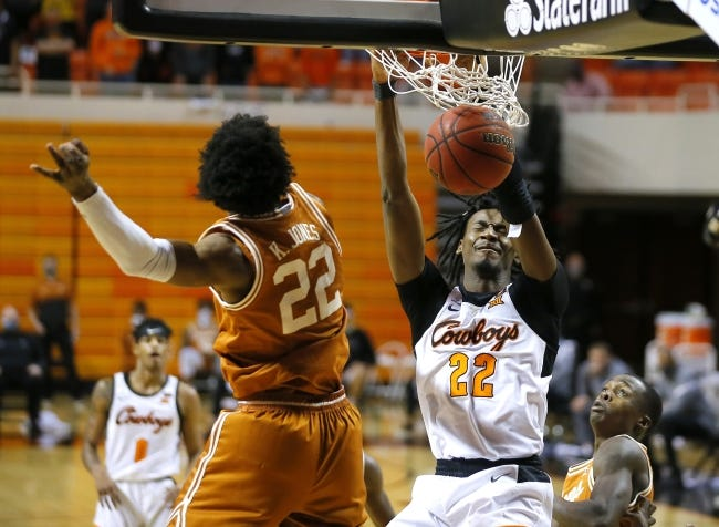 OSU's Kalib Boone (22) dunks the ball between Texas' Kai Jones (22) and Andrew Jones (1) during a 75-67 double-overtime win Saturday in Stillwater. [Bryan Terry/The Oklahoman]