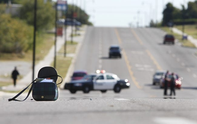 In this 2010 photo, a purse remains in the center of NW 23 after a woman was hit by a car as she attempted to cross the street near Martin Luther King Avenue in Oklahoma City. [Oklahoman Archive Photo]