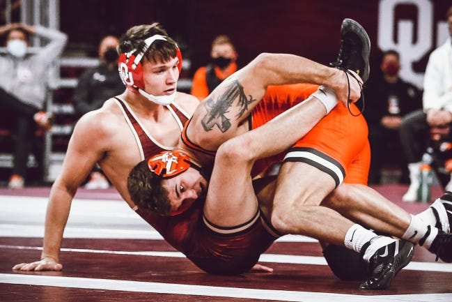 Oklahoma State's Travis Wittlake and OU's Troy Mantanona wrestle in the 165-pound match of Bedlam on Sunday at the Lloyd Noble Center. [BRUCE WATERFIELD/OSU ATHLETICS]