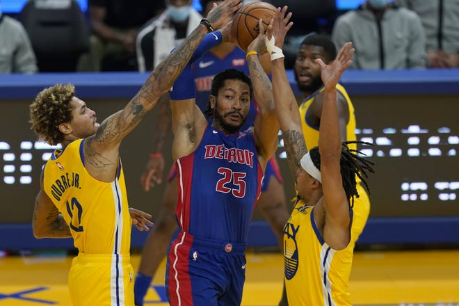 Derrick Rose, center, is reportedly being traded to the New York Knicks by the Detroit Pistons. [AP Photo/Jeff Chiu]