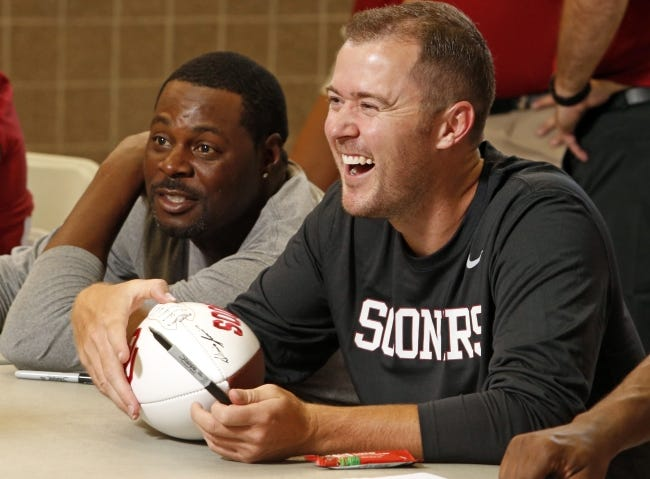 Lincoln Riley, signing autographs during Meet the Sooners Day in 2015, brought Dennis Simmons to OU when he was hired as offensive coordinator. Now the OU head coach, Riley considers Simmons among his closest confidants. Simmons is also one of the best assistants in college football. [OKLAHOMAN ARCHIVES]