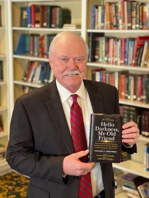 "The Rev. Bob Long, senior pastor of St. Luke's United Methodist Church in Oklahoma CIty, holds Sanford Greenberg's book ""Hello Darkness, My Old Friend."" [Provided]"