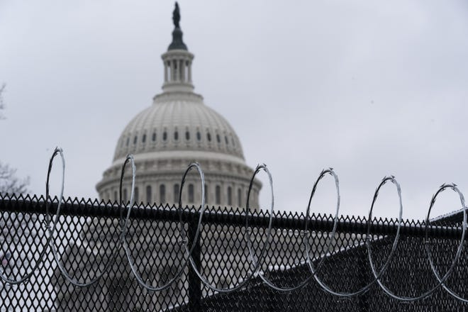 Former President Donald Trump's second impeachment trial will begin in earnest Tuesday with a debate and vote on whether it's constitutional to prosecute the former president. There will likely be no witnesses, and the former president has declined a request to testify. An anti-scaling fence topped with razor wire surrounds the U.S. Capitol in this photo from last week. The fence was put up after the riots on Jan. 6. [Alex Brandon/AP Photo]