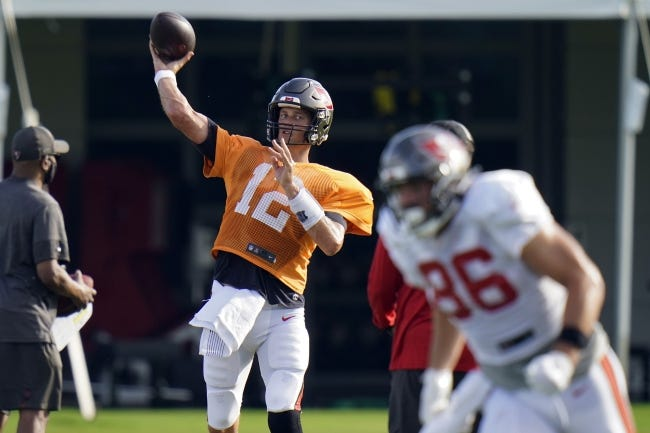 Buccaneers quarterback Tom Brady (12) throws a pass to tight end Codey McElroy (86) during a practice in training camp on Aug. 18 in Tampa, Fla. [AP Photo/Chris O'Meara]