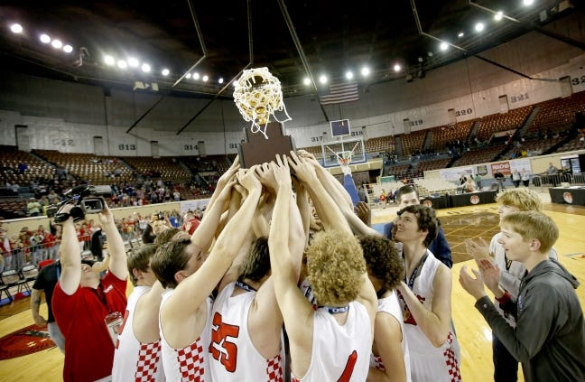 Duke celebrates winning the Class B state basketball title at State Fair Arena on March 7, 2020. [Sarah Phipps/The Oklahoman]