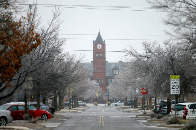 A layer of ice covers the street and trees west of Old North at the University of Central Oklahoma in Edmond, Okla., Wednesday, Feb. 10, 2021. [Bryan Terry/The Oklahoman]