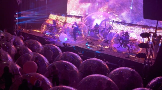 """After a couple of test runs, the Lips staged what were billed as """"the World's First Space Bubble Concerts"""" Jan. 22-23 at The Criterion in Bricktown. All the band members and audience members were in plastic orbs for the shows, with each Space Bubble accommodating up to three people. [Scott Booker photo]"""