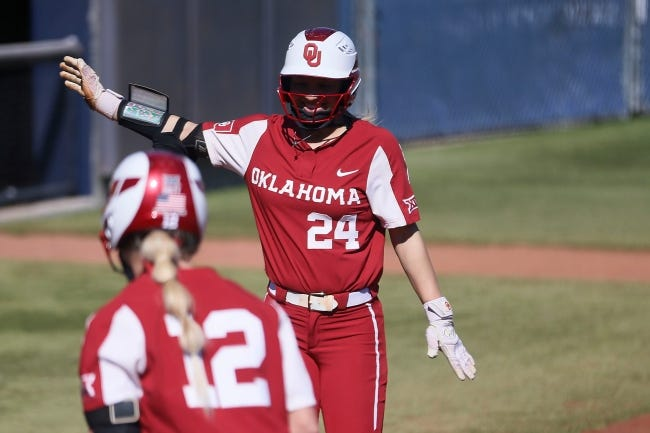 OU's Jayda Coleman (24) runs home after hitting one of the Sooners' 13 home runs Thursday in a 29-0 season-opening win at UTEP. [BRIANA SANCHEZ/EL PASO TIMES]
