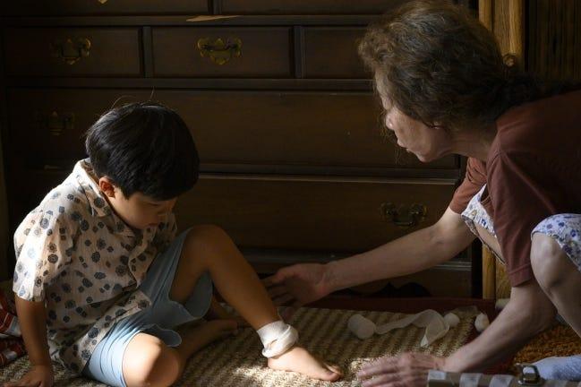 "Alan S. Kim, left, Yuh-Jung Youn star in Lee Isaac Chung's family drama ""Minari."" [Melissa Lukenbaugh/A24]"