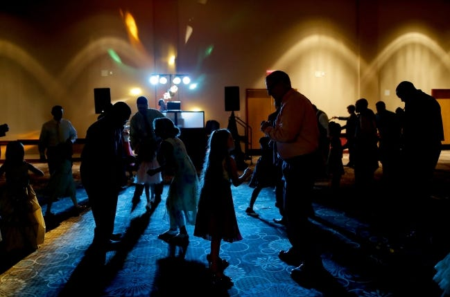 The dance floor is filled during a previous year's Midwest City Daddy Daughter Dance event. This year, the city is planning a virtual event on Feb. 20. [BRYAN TERRY/THE OKLAHOMAN ARCHIVES]