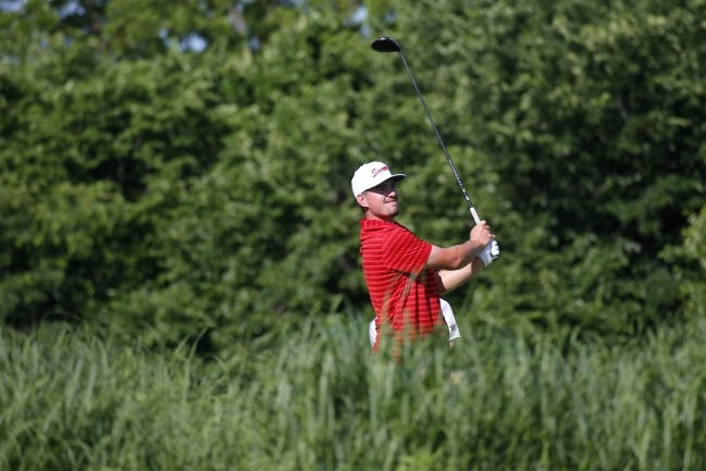Oklahoma's Quade Cummins watches his tee shot during the 2018 NCAA golf championship in Stillwater. Cummins and the top-ranked Sooners will not play in the All-American Intercollegiate in Houston this weekend after the event was canceled due to inclement weather. [Bryan Terry/The Oklahoman]