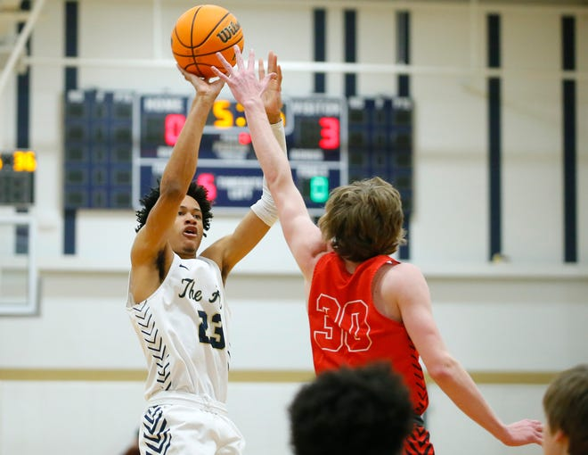 Heritage Hall's Trey Alexander shoots over Cooper Gudell of Crossings Christian during a high school basketball game between Heritage Hall and Crossings Christian in Oklahoma City, Friday, Feb. 12, 2021. [Bryan Terry/The Oklahoman]