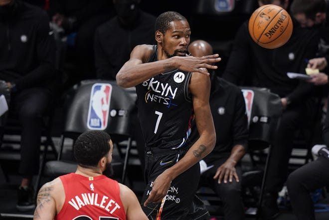Brooklyn Nets forward Kevin Durant (7) passes away from Toronto Raptors guard Fred VanVleet during the first half of a game Feb. 5 in New York. [AP Photo/Frank Franklin II]