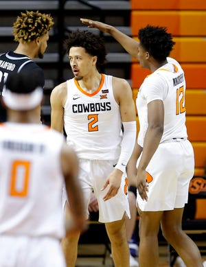 Oklahoma State's Cade Cunningham and Matthew-Alexander Moncrieffe (12) react after a Cunningham dunk in the first half during a men's college game between the Oklahoma State Cowboys and the Kansas State Wildcats at Gallagher-Iba Arena in Stillwater, Okla., Saturday, Feb. 13, 2021. Photo by Sarah Phipps, The Oklahoman