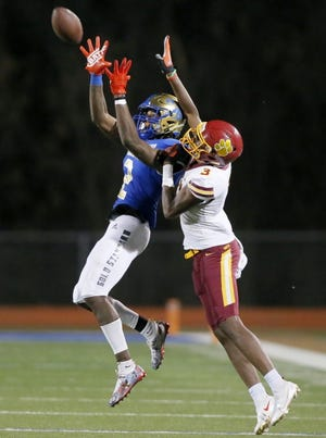 Choctaw's Jordan Mukes tries to intercept a pass intended for Putnam City North's Jeff Nwankwo during a high school football game on Nov. 20 in Choctaw. [Bryan Terry/The Oklahoman]