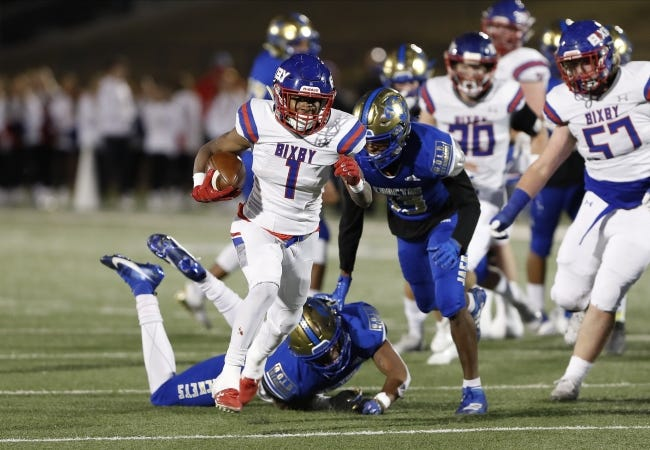 Bixby's Braylin Presley (1) escapes a tackle by Choctaw for a first down during the Class 6A-II football title game in Edmond on Dec. 5. [ALONZO J. ADAMS/FOR THE OKLAHOMAN]