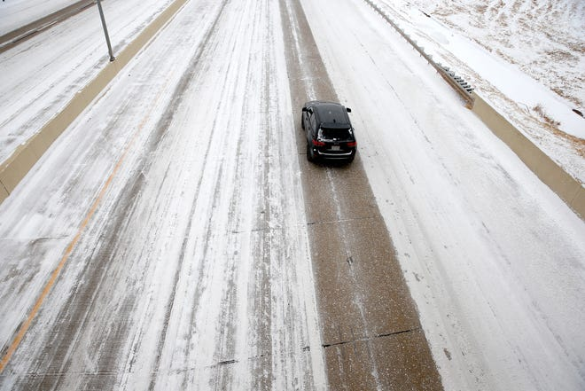 A car travels east on the Kilpatrick Turnpike in Oklahoma City, Sunday, Feb. 14, 2021. Photo by Sarah Phipps, The Oklahoman