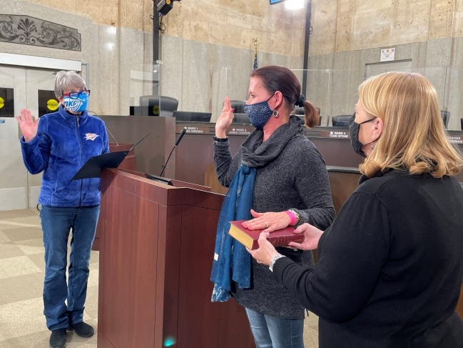 Amy Simpson, center, is sworn in Friday as Oklahoma City's new city clerk. Retiring City Clerk Frances Kersey, left, administers the oath. Assistant City Manager Laura Johnson, right, assists. [CITY OF OKLAHOMA CITY]