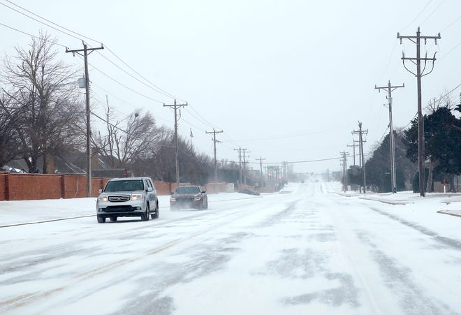 Cars travel east on NW 164th in northwest Oklahoma City, Sunday, Feb. 14, 2021. Photo by Sarah Phipps, The Oklahoman