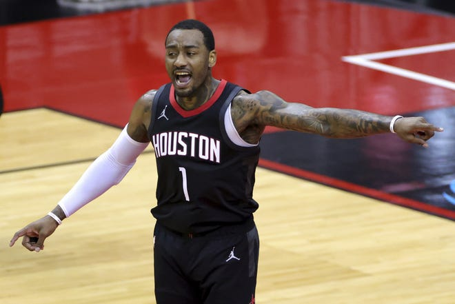 Houston's John Wall reacts to a call during the fourth quarter of Thursday's game against the Miami Heat. [Carmen Mandato/Pool Photo]