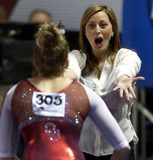 Oklahoma's K.J. Kindler, right, notched her 400th victory as the Sooners' women's gymnastics coach Saturday night. [Bryan Terry/The Oklahoman