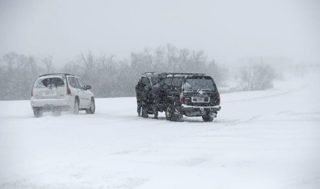 A car is stalled along Pennsylvania Avenue during the historic winter storm on Sunday. [SARAH PHIPPS/THE OKLAHOMAN]