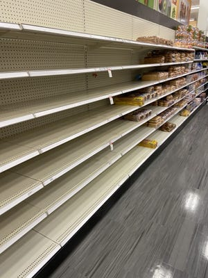 Bare shelves in the bread section of grocery stores across the metro are commonplace during winter storms. [Photo by Doug Hoke/The Oklahoman Archives]