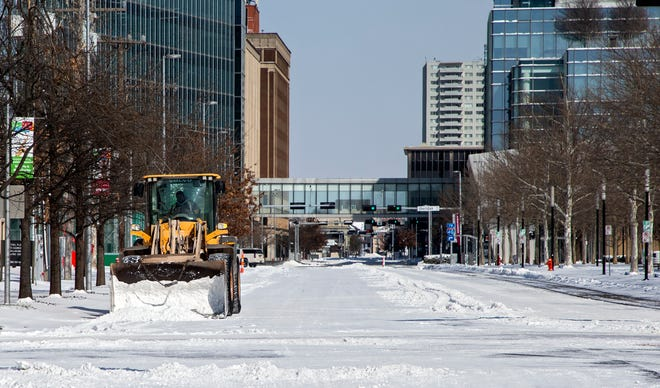 Crews work to remove snow from Hudson Ave. in Oklahoma City, Okla. on Monday, Feb. 15, 2021. [Chris Landsberger/The Oklahoman]