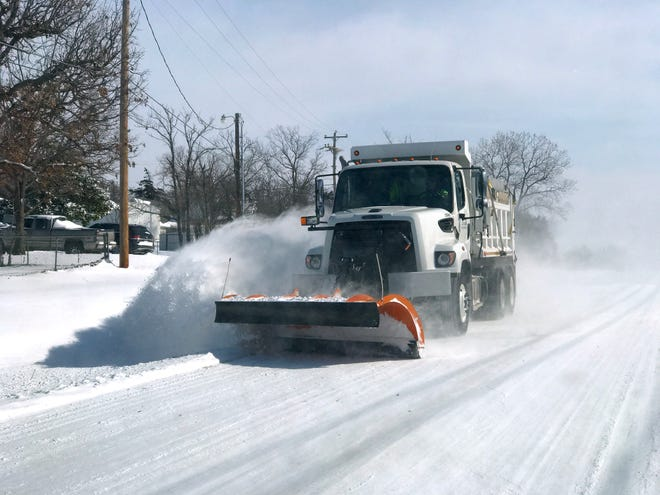 A truck from City of Edmond plows snow going west on E. 33rd St in Edmond Monday, February 15, 2021. [Doug Hoke/The Oklahoman]