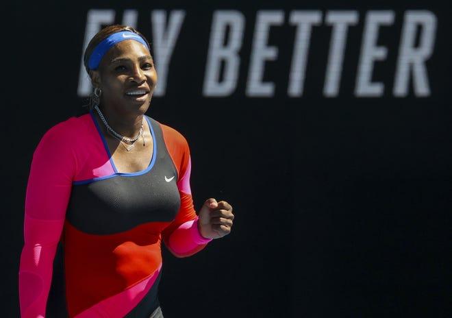 Serena Williams celebrates after winning her fourth-round match against Aryna Sabalenka at the Australian Open in Melbourne, Australia, on Sunday. [AP Photo/Hamish Blair]