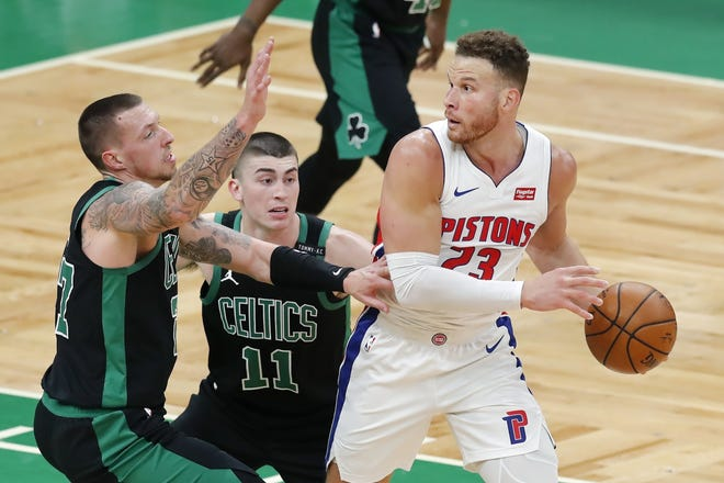 Boston's Daniel Theis, left, and Payton Pritchard, center, defend against Detroit's Blake Griffin during the second half of a game on Friday. Griffin is expected to leave the Pistons via trade or buyout. [AP Photo/Michael Dwyer]