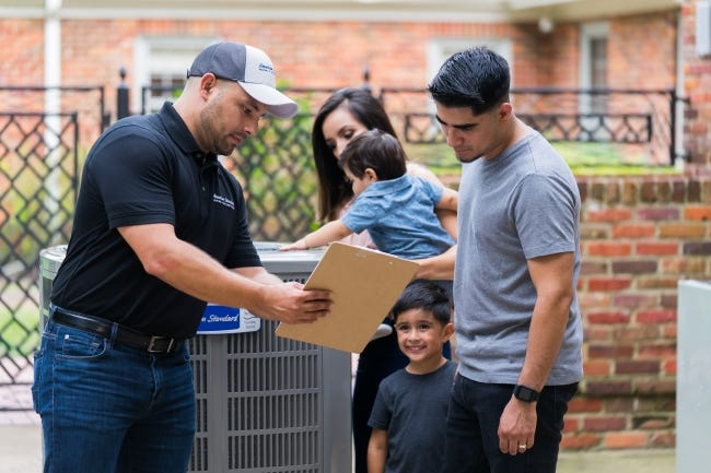 Cool comes at a price. The average home needs a new HVAC system every 15-20 years. Yes, it's expensive, but homeowners benefit from energy savings and peace of mind. Here, customers talks to an American Standard technician while their baby touches the air conditioner. [PROVIDED/AMERICAN STANDARD]