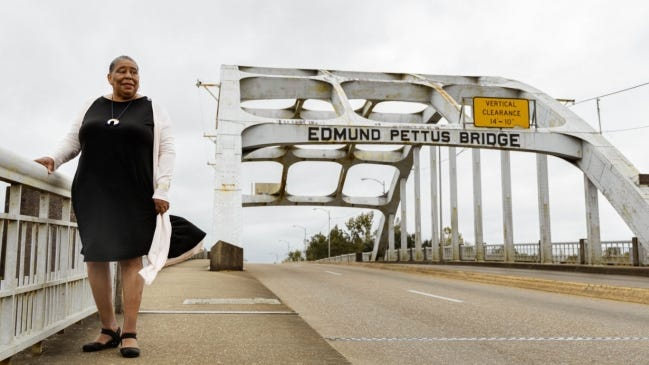 """JoAnne Bland, a civil rights activist who took part in the """"Bloody Sunday"""" march across the Edmund Pettus Bridge, poses for a picture on the bridge in her hometown of Selma, Alabama. [Jazmine Powers Photography]"""