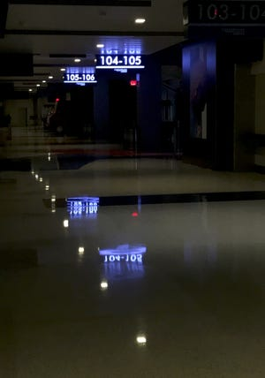 The darkened concourse is seen before Tuesday's Thunder-Blazers game at Chesapeake Energy Arena. [Bryan Terry/The Oklahoman]