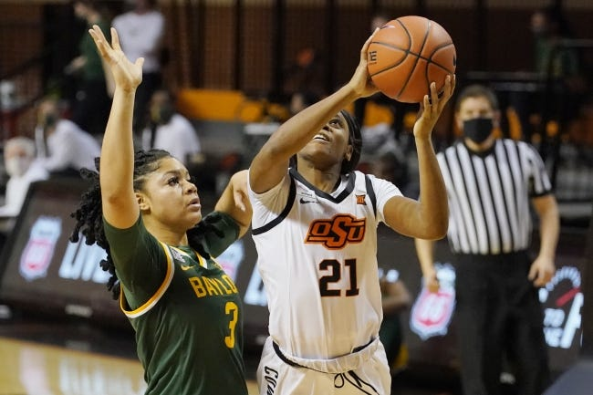 Oklahoma State guard Ja'Mee Asberry (21) goes to the basket in front of Baylor guard Trinity Oliver (3) in the second half on Jan. 20 in Stillwater. [AP Photo/Sue Ogrocki]