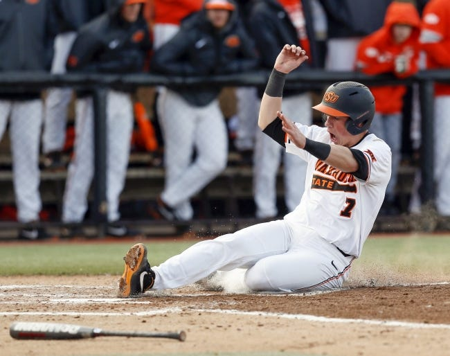 OSU's Max Hewitt (7) slides home in the third inning of a game against UT-Rio Grande Valley Vaqueros in last year's home opener at Allie P. Reynolds Stadium in Stillwater. [THE OKLAHOMAN ARCHIVES]