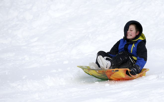 Jace Enright sleds on a hill Wednesday along Hefner Road in Oklahoma City. Forecasts of warmer temperatures by this weekend suggest the time for sledding is limited. [Sarah Phipps/The Oklahoman]